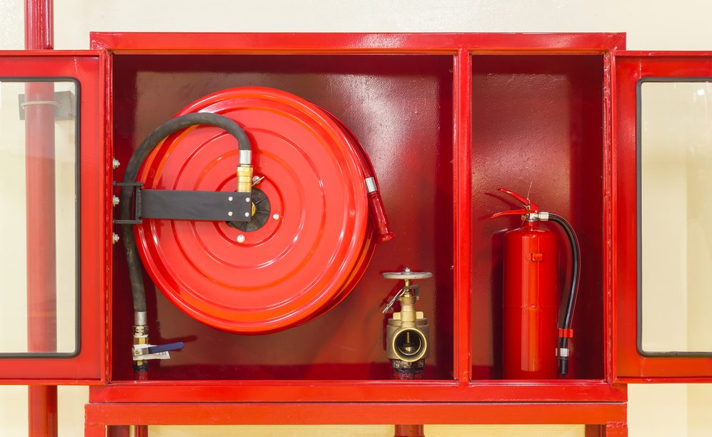 Closed-up red cabinet for Fire Extinguisher, Fire Hose and Fire Hose Valve