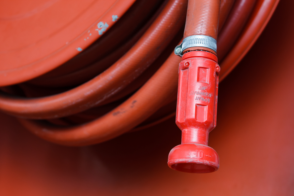 red-fire-hose-in-the-reel