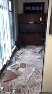 office damage due to roof collapse and rain water